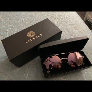 Round Versace glasses